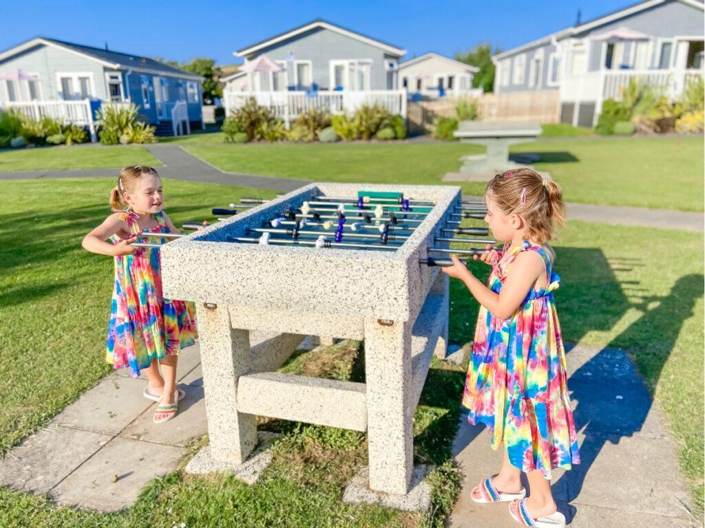 two girls playing table football at Croyde Bay resort