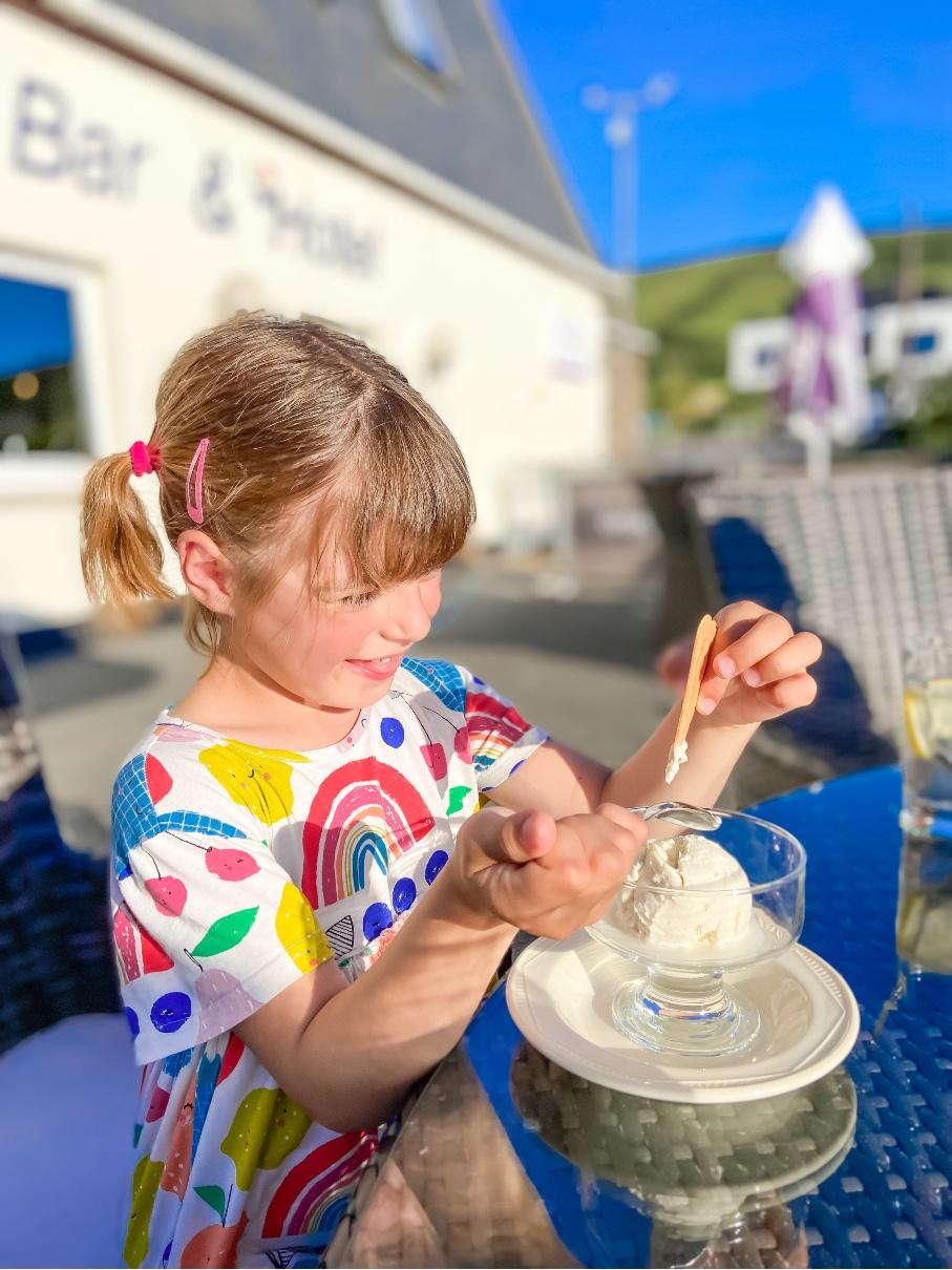 little girl eating dinner at Croyde Bay resort restaurant