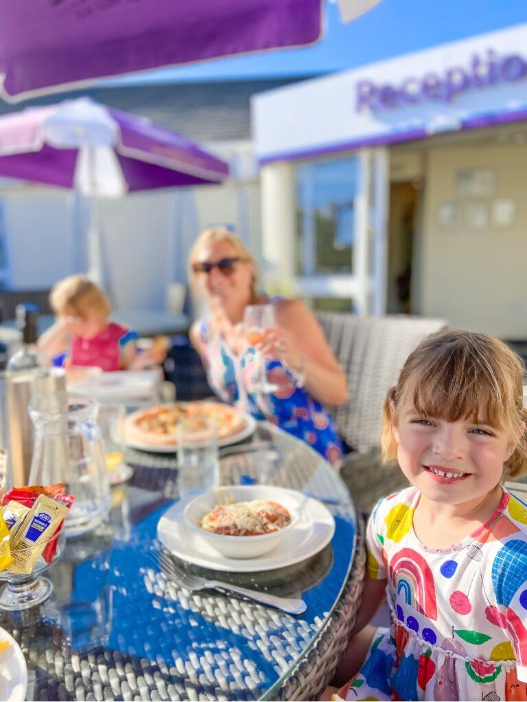 little girl eating dinner at Croyde Bay resort