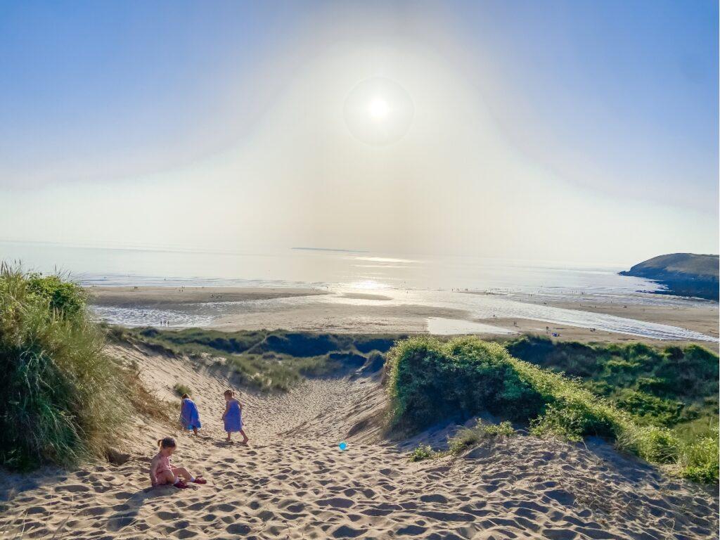 Children walking up the dunes at Croyde Bay beach